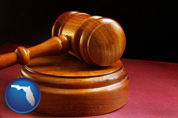 an arbitrator's wooden gavel - with Florida icon