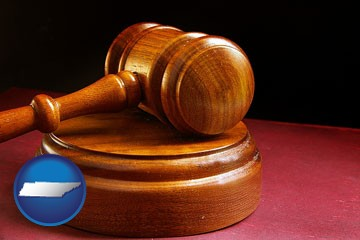 an arbitrator's wooden gavel - with Tennessee icon